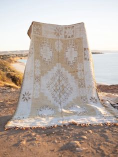 Kiss the Sky is a vintage Boujaad rug with beautifully designed Berber motifs, featuring a desert palette of natural white, sand and faded coco hues. Soft under foot and in excellent vintage condition with tassels in tact, this gorgeous rug will elevate any space. Atlas Mountains, Morocco, Vintage Rugs, Tassels, Hand Weaving, Kiss, Im Not Perfect, Palette, Moroccan Rugs