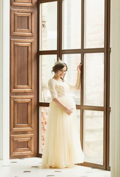 A dreamy romantic maternity photo featuring a beautiful mom-to-be crowned with joy and glory!