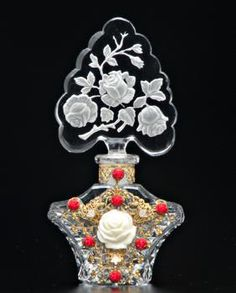 CZECH Perfume bottle in clear crystal with red and white jeweled and enameled filigree metalwork, rose stopper with dauber stub, 1920s.