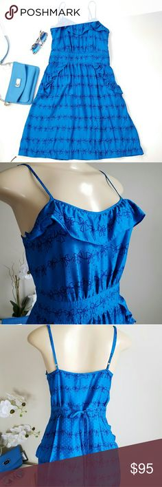 """Marc by Marc Jacobs bow-patterned silk dress Blue Streak Multi jacquard fabric with navy blue bow pattern dress. Ruffled top, adjustable straps and waist ties in back. Side pockets, left side zipper closure. Fits up to a size 4. Worn once. Excellent condtion. Approx 16.5"""" across chest, 27"""" long Marc by Marc Jacobs Dresses"""