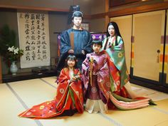 A family wearing heian robes.