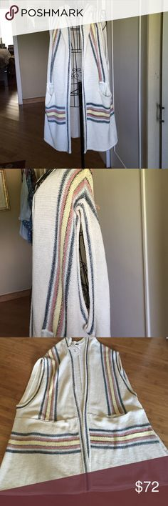 FREE PEOPLE SWI G SWEATER CARDIGAN VEST IVORY Cardigan vest in ivory with denim blue, yellow and peach stripes with 2 pockets on front large armholes could wear a tank top or heavy sweater underneath.  Washable cotton/linen lightweight, never worn size XS/S but a medium could wear it Free People Jackets & Coats Vests