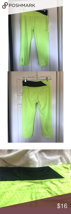Women's S Nike Dri-Fit Neon Yellow Jogger Pants Bright yellow knee/calf length Nike Dri-fit jogger pants in awesome condition! Women's small.   Fabric has no stretches, tears or marks. Features small black dots and a zippered back waistband pocket. Tag is a little faded, (see picture).  From a smoke-free home! Message if you have any questions! :) Nike Pants Track Pants & Joggers