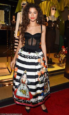 Headliner: Zendaya stood out from the crowd in a dress made from a low-cut bustier bodice and full-length colorful skirt at a Dolce & Gabbana party Thursday night in Beverly Hills