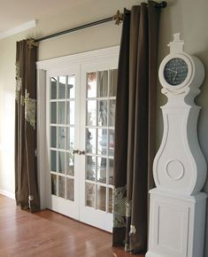 Oooh, never thought about putting drapes beside the french doors in the office.