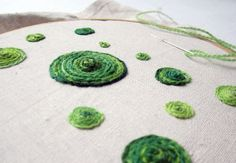 Technically this is yarn, it's just not knitting. Embroidery on linen with scrap yarn.