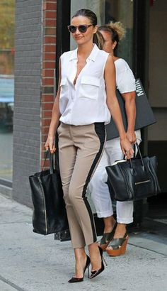 Miranda Kerr Never Has an Off Day — See How She Does It: In a breezy sleeveless blouse and tuxedo-striped pants, Miranda's daywear is cooler than most; it all comes down to proportions and sophisticated details, like her posh pointed-toe Manolos.