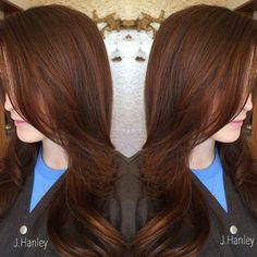 dark brown hair with subtle red highlights