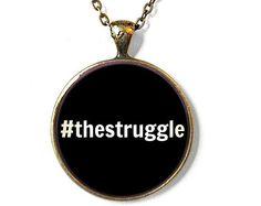 The struggle pendant necklace