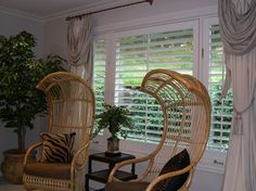 Wide louver plantation shutters draw sunlight through the window. Traditional Shutters, Indoor Shutters, Painting Shutters, Interior Shutters, Through The Window, Custom Wood, Hanging Chair, Sunlight, Draw