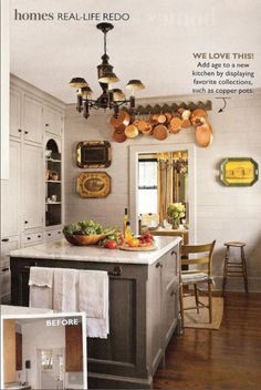 Love this gray kitchen. I especially love the copper pots & trays hanging. Great display.