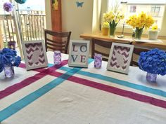 Table decoration for baby shower in purple, blue and white