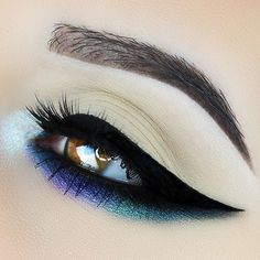 This edgy look by @emilyann_mua will be sure to make the right impact for any day of the week!  Makeup Geek Eyeshadows in Houdini, Pegasus,  Masquerade,  Phantom,  and Blacklight. Makeup Geek Duochrome Pigment in Sugar Rush.