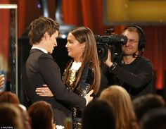 The Swedish actress paused to greet her co-star Eddie Redmayne on her way to collect her trophy