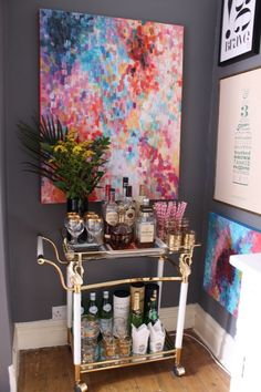 love the bar cart and lots of art