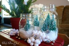 Little snowscapes inside glass jars - these would make for lovely accents in a room.