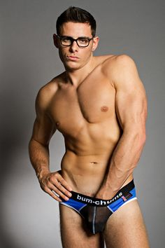 Hunky shirtless nerd wearing blue/black mesh briefs and glasses