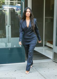 Edgy: Tailored to fit her curvy figure, she wore the suit without a slip...