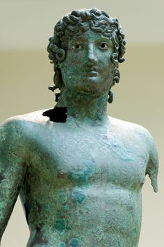 Statue of a young man. Bronze, Roman copy of the 1st century BC after a Greek original. Courtesy & currently located at the British Museum, London. Photo taken by Marie-Lan Nguyen