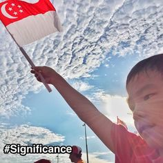 "Singapore flag representing StrengthsFinder Significance. My son Caden waving the Singapore flag high and proud during the National Day Parade rehearsal on Sat. Significance is about being great and doing great feats of excellence or achievement. Things that people will recognize. And Singapore as a small country does that resoundingly. Singapore is seen by many as a modern day ""economic miracle"". A small country just on the southern tip of Malaysia was able to make her mark on the world…"