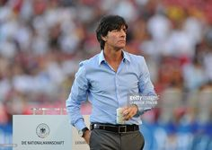 Germany's head coach Joachim Loew leaves the pitch after the warming up ahead of the Germany vs Brazil international friendly football match at the Mercedes-Benz Arena in Stuttgart, southern Germany, on August 10, 2011. Germany won the match 3-2.