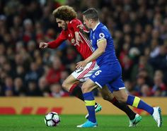 Marouane Fellaini of Manchester United and Phil Jagielka of Everton battle for possession during the Premier League match between Manchester United...