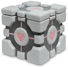 Aww... it's the lovely companion cube from Portal, in cookie jar form.