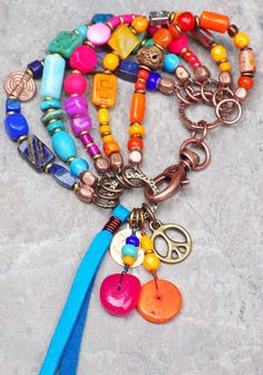 Gypsy Hippie Charm Bracelet $135 Rock your gypsy soul with this fantastic, colorful, bohemian, hippie charm bracelet! I can do this in any colors you want and I can change out the charm too. This is such a fun, easy to wear, soulful style and it makes a great gift too!