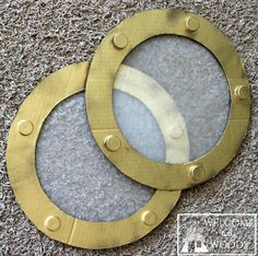 "A great photo tutorial on how to make an easy diy faux porthole. Cut out of cardboard, glue on bottle caps, spray paint, and the ""window"" is wax paper."