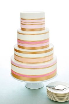DIY wedding cake idea: Decorate a plain white tiered cake with different widths / color of ribbons.