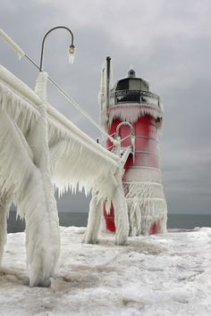 More Ice by Thomas Zakowski via 500px: Lighthouse in Michigan #Photography #Ice #Lighthouse #Michigan