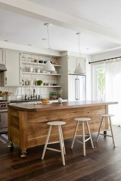 Wooden plank island on rollers. Photo, David Gilbert via Remodelista, via Charlotte Minty Interior Design.