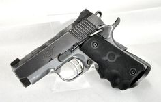 """Kimber Tactical Ultra II .45 ACP. The Tactical Ultra II from Kimber is a semi-automatic lightweight tactical pistol. Small and light enough for backup, and perfect for concealed carry. It features a matte gray aluminum frame, matte black steel slide, a Match grade steel barrel, premium aluminum Match grade trigger, ambidextrous thumb safety, and fixed Meprolight Tritium 3-dot night sights. Black wraparound rubber Hogue grips. 7+1 capacity of .45 ACP. 3"""" barrel. 25 oz. [Pre-Owned] $999.99"""