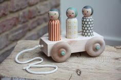Wooden Trolly Dolly pull-along toy  - 3 large people. £22.50, via Etsy.