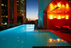 Downtown LA, Los Angeles, California, USA: Standard hotel rooftop on former Superior Oil company building; heated swimming pool, red AstroTurf deck, nightly DJs, bar