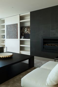 Monochrome palette simplicity from Chelsea Hing. Love the sliding door across the shelving.