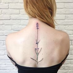 Lavender Floral Spine Tattoo in Purple and Green