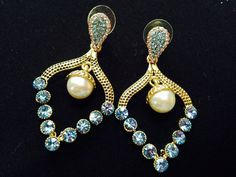 Sky blue dangler earing with pearl.