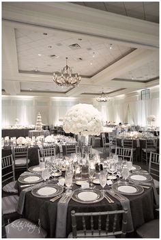 silver and white wedding reception, hurricane vase center pieces, custom linens, silver chiavari chairs, clear glass chargers- I think this is at Ballantyne resort Silver Wedding Decorations, Wedding Themes, Table Decorations, Wedding Ideas, Decor Wedding, Wedding Favours, Wedding Photos, Wedding Dresses, 25th Wedding Anniversary