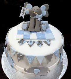 1st birthday cake - with baby elephant theme! See my facebook page A Cupful of Cake or www.acupfulofcake.co.uk for all my cake and cupcake bakes!