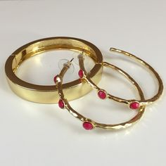 Bangle Set Gold tone metal hinge bangle complimented by gold tone hoop pierced earrings with hot pink flat and faceted bead design. Jewelry Bracelets