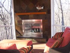 Outdoor Rooms with Fireplaces   ... Outdoor Room Features   Slate front fireplace in Wildwood Screen Room