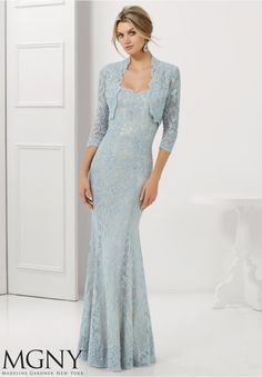 Evening Gowns and Mother of the Bride Dresses by MGNY Stretch Lace with Beaded Appliques and Edging Matching Bolero Jacket. Available in Navy/Nude, Black/Nude, Silver/Nude, Taupe.
