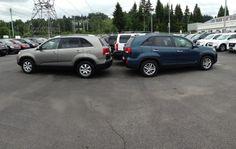 Back to back Kia Sorento SUVs on the pre-owned lot!