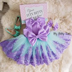 NEW! Available in all sizes, up to 9 years Demi Dress in Teal & Purple Shop ittybittytoes.com