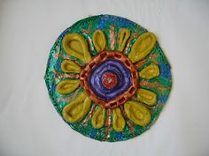 Color, collage, and much more: Clay Mandalas