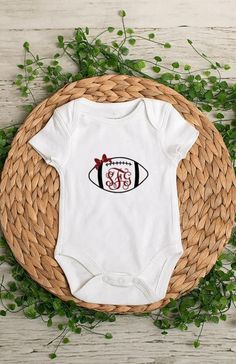 Monogram Football with Bow Bodysuit or t-shirt This is a perfect gift and great for football season. We are also able to do the bow and monogram in glitter vinyl for an additional fee. Request a custom order for this upgrade!  *Bodysuits are Carter's brand. Please see their sizing chart if you