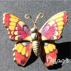 //V i n t a g e • B u t t e r f l y • B r o o c h/ NICE!!! Butterfly brooch with many colors.  Gold tone base. This one is for the butterfly LOVERS. I have another one in my closet with a silver base. Great for any coat. T shirt. Top. Vintage. -No trades. Vintage Jewelry Brooches