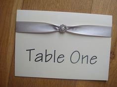 Wedding table name number card with pearl embellishment in silver