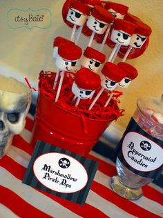 """Marshmallows dipped in red candy melts and decorated with a black sugar pen become """"Pirate Pops"""""""